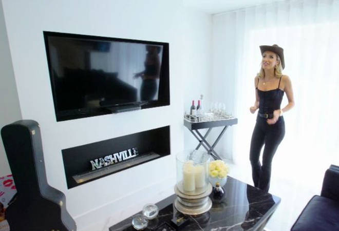 Megan's living room looks like a show home and has a Nashville sign in the fireplace