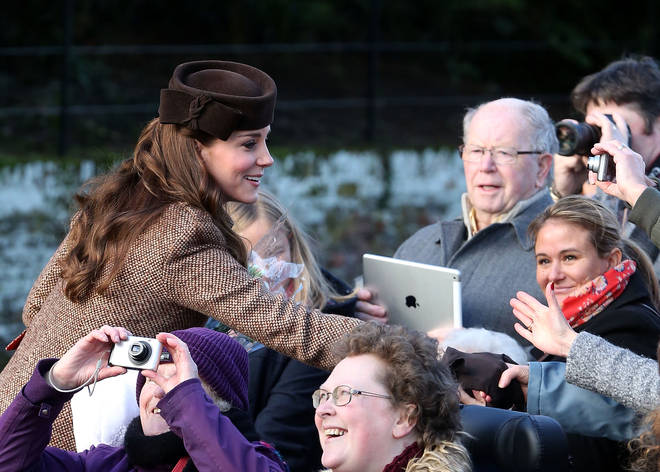Catherine, Duchess of Cambridge meets members of the public as they leave the Christmas Day Service at Sandringham Church in 2015