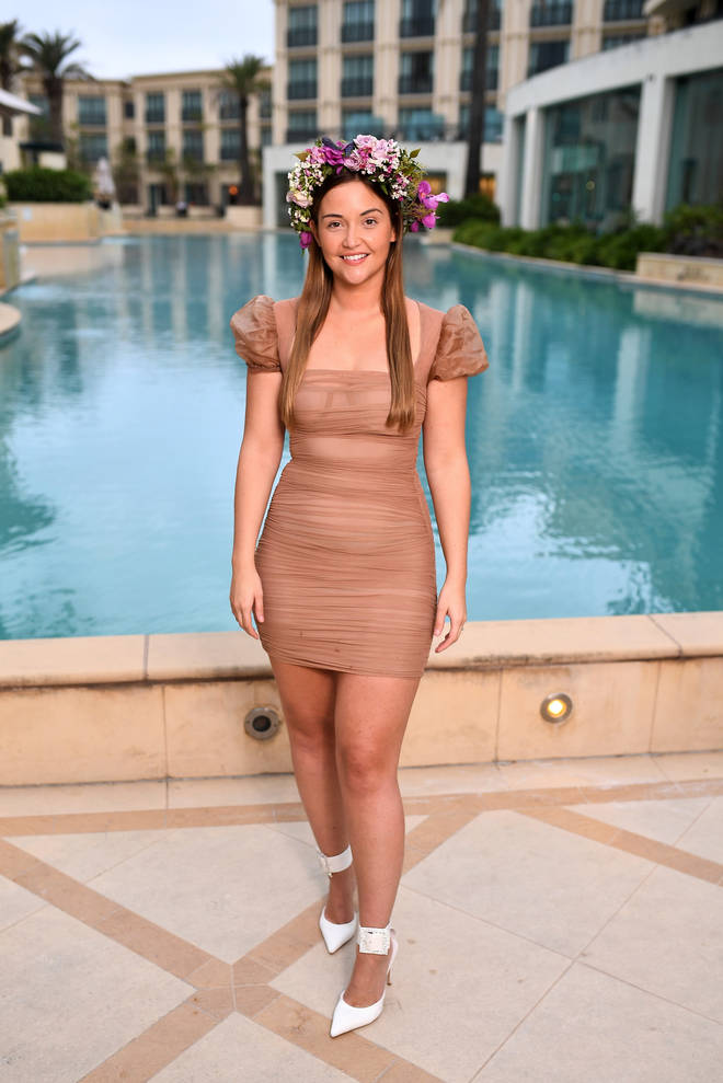 She posed by the pool at the lavish hotel following her crowning as the queen of the jungle 2019