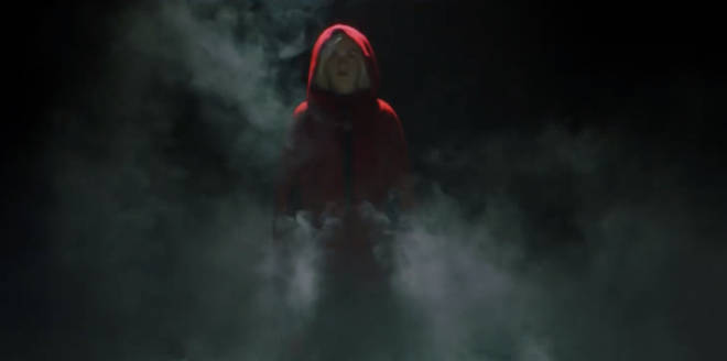 The new series' teaser shows Sabrina in a red cloak in the darkness