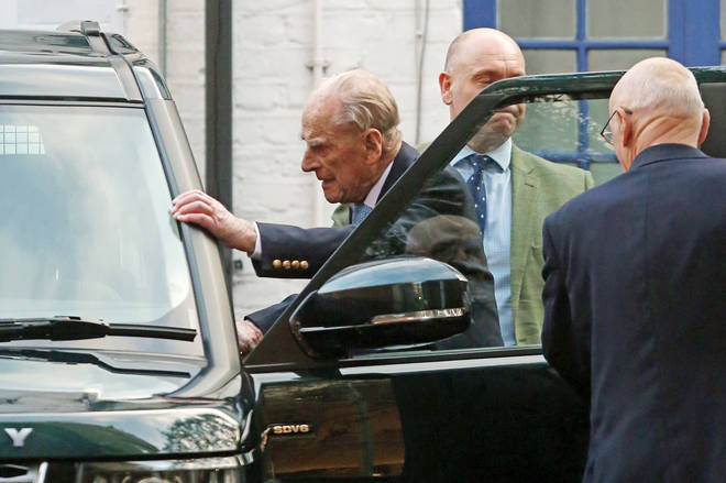 The Duke reportedly looked tired and frail as he left the hospital this morning, but walked to his car in a smart shirt and suit