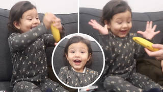 This little girl was so excited to be given a banana for Christmas