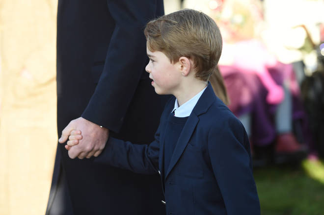 Prince George was dressed in a navy suit as he held his father's hand