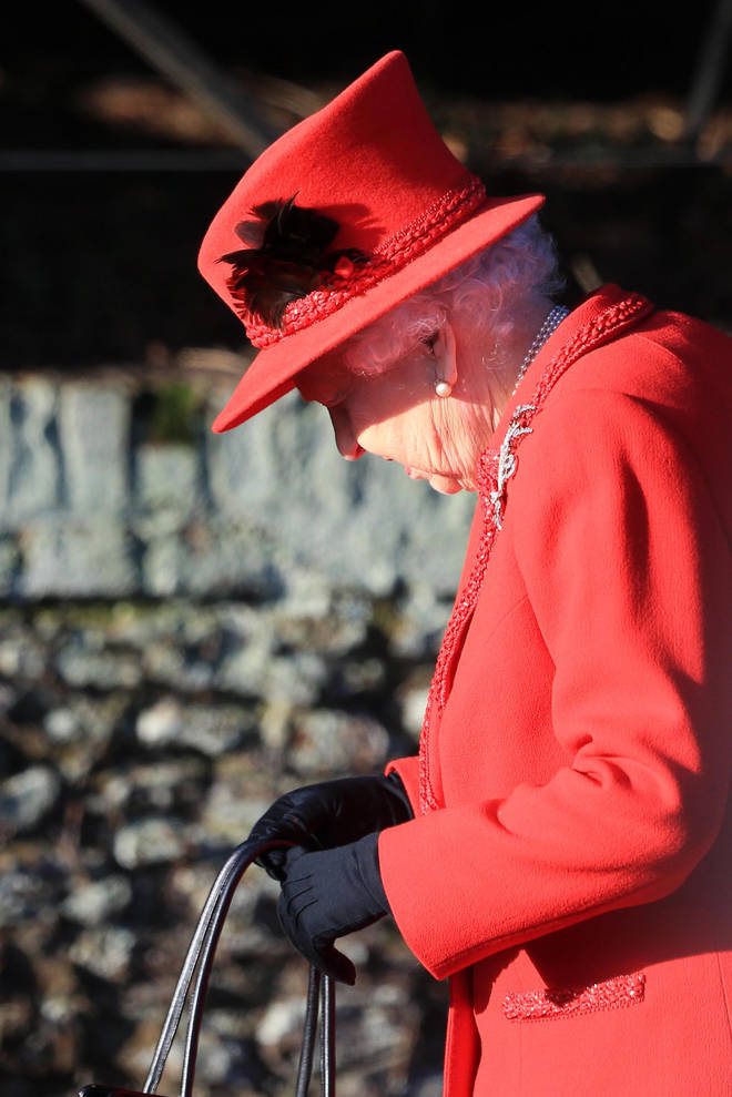 The Queen looked festive in a red ensemble