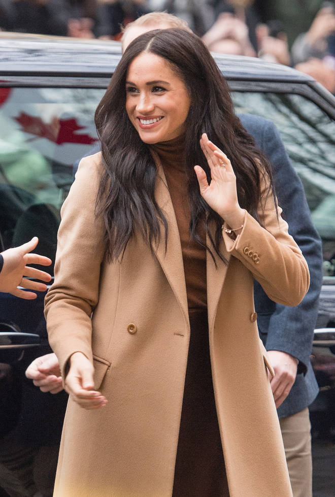 The Duchess of Sussex looked amazing in a brown skirt and jumper, teamed with a camel coat