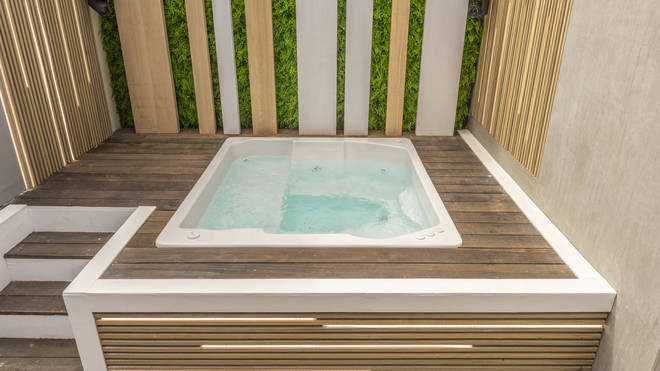 The villa features a brand-new hot tub