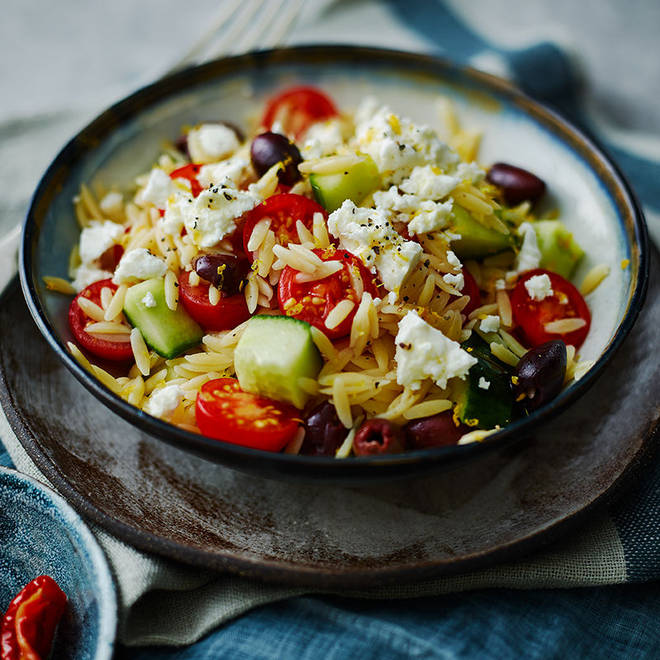 Greek salad gets a twist with the addition of tiny pieces of pasta