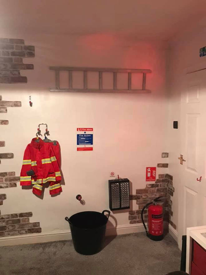 The room is complete with a ladder and fire extinguisher too