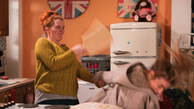Fiz hits Jade over the head with a chopping board
