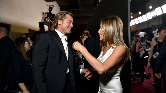 Brad and Jen were spotted getting cosy at the awards