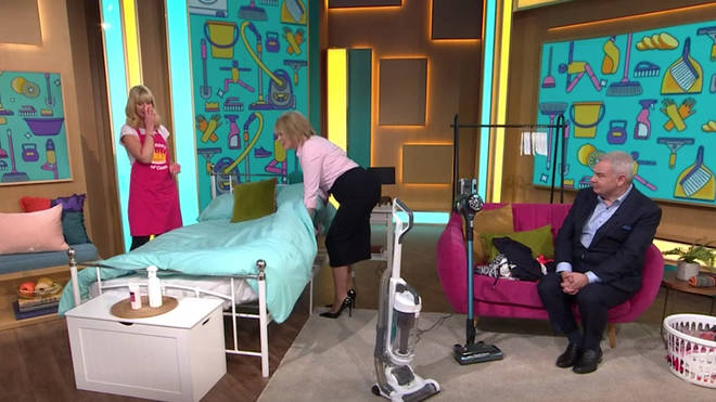 Ruth Langsford was told to 'squat' while making the bed