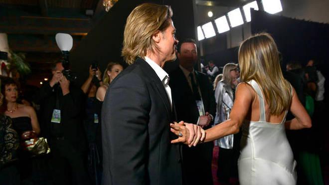 Brad Pitt grabbed Jennifer Aniston's wrist