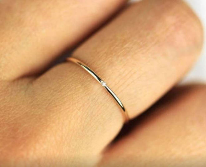 The minimal ring features a tiny diamond