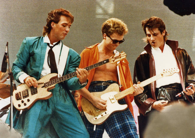 Martin and Gary Kemp with Tony Hadley performing at Live Aid in 1984