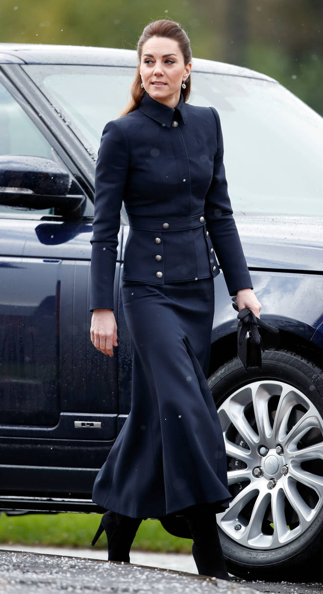 Kate Middleton often holds bags in her left hand