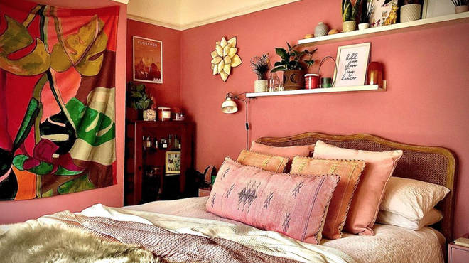 The bedroom features a warm, pink colour scheme