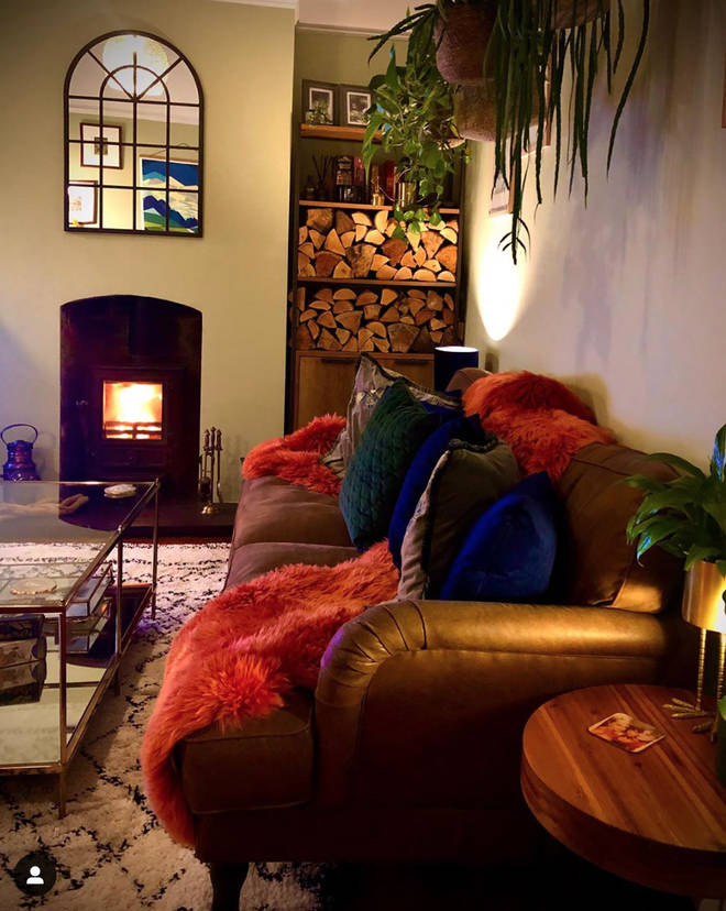 The living room features cosy soft furnishings