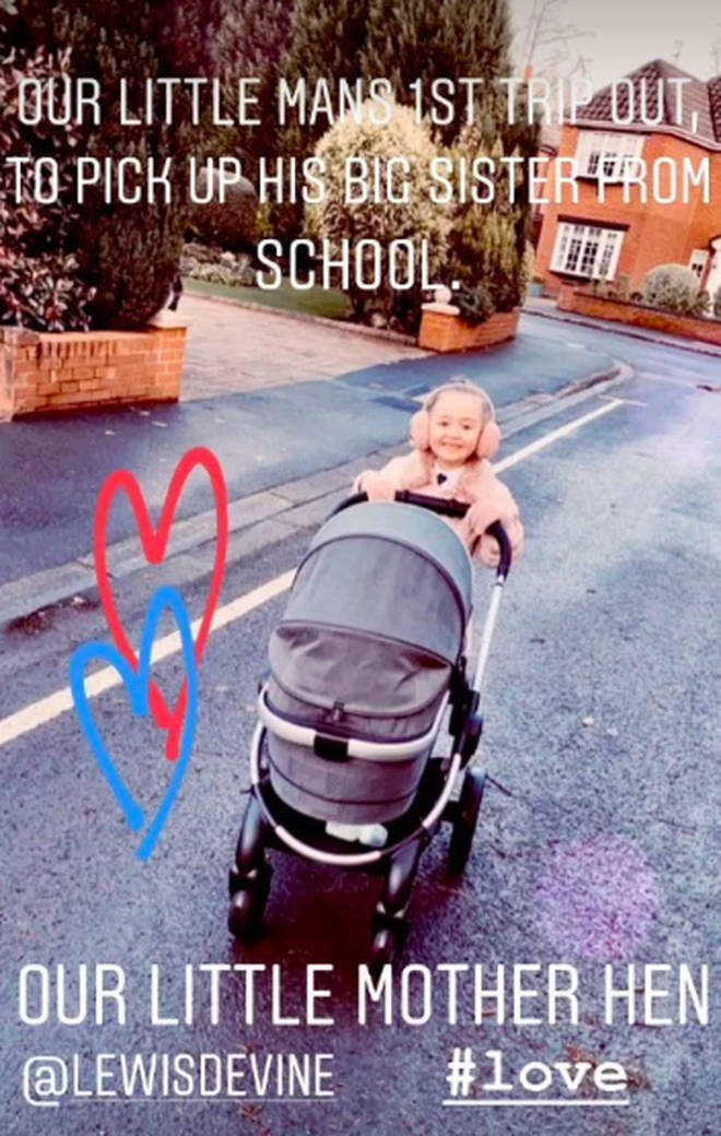 Sienna pushes her little brother in his buggy