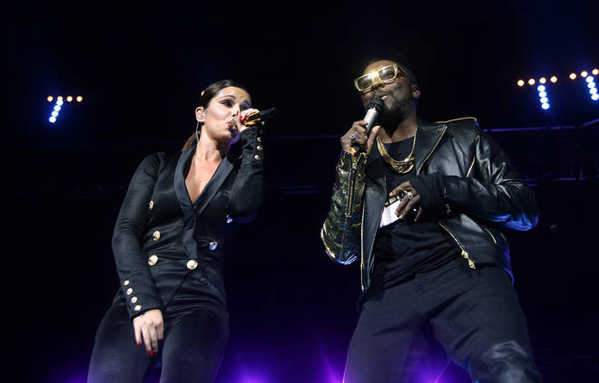 Cheryl and Will.i.am performing