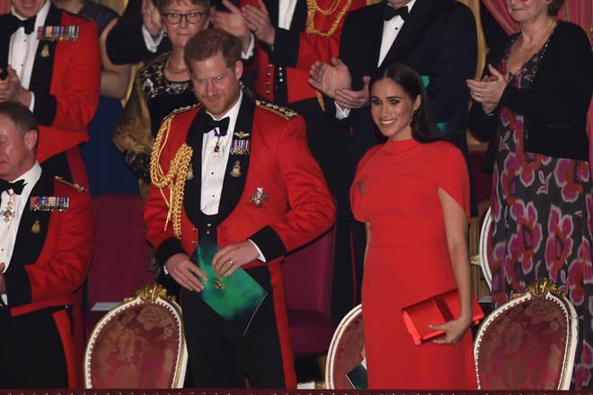 Harry and Meghan were in good spirits as they beamed at cheering crowds.