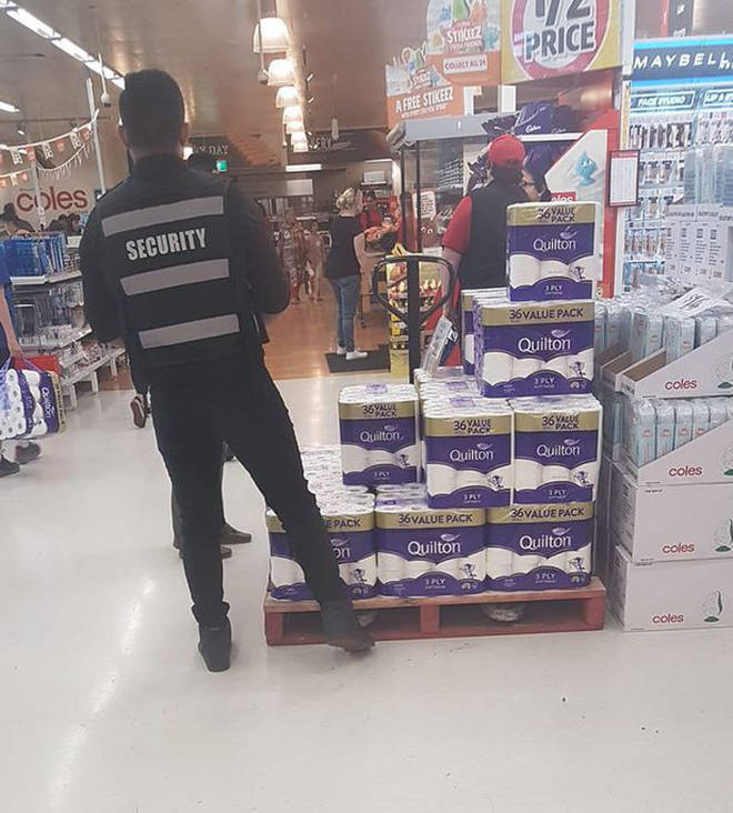 One supermarket has security staff guarding the toilet paper