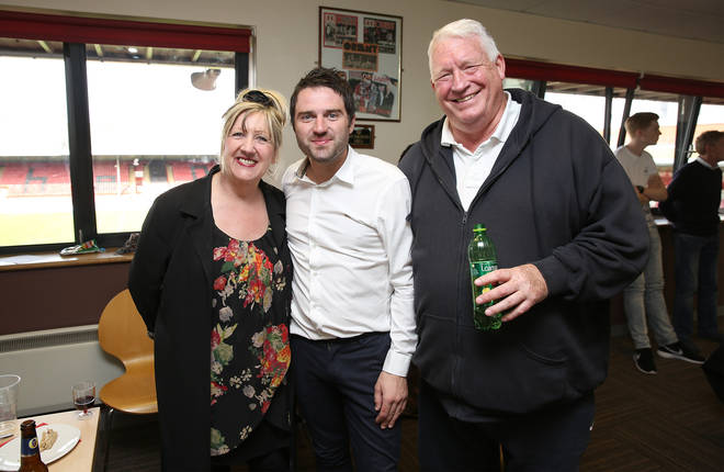 Linda, George and Pete pictured at a charity football match in 2015