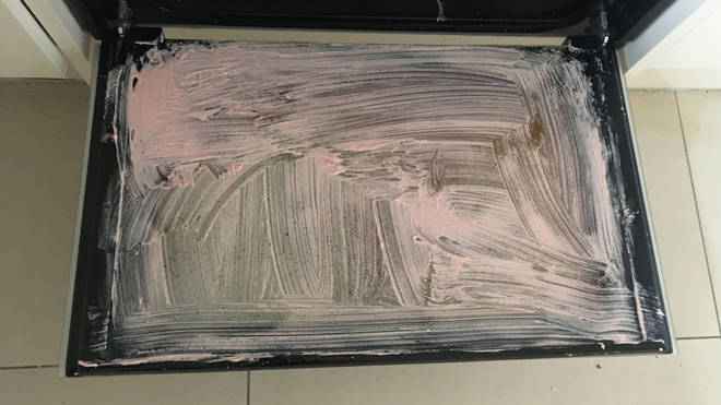 A layer of Pink Stuff was smeared over the door after the dishwasher tablet did all it could to dissolve the grease and grime