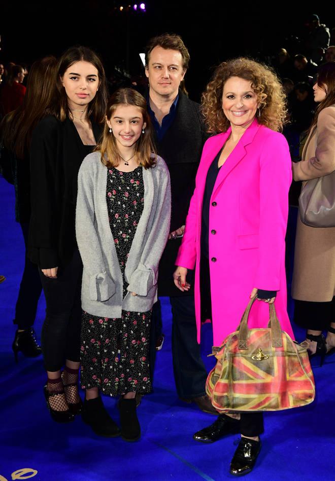 Nadia Sawalha, husband Mark and their daughters Maddie and Kiki