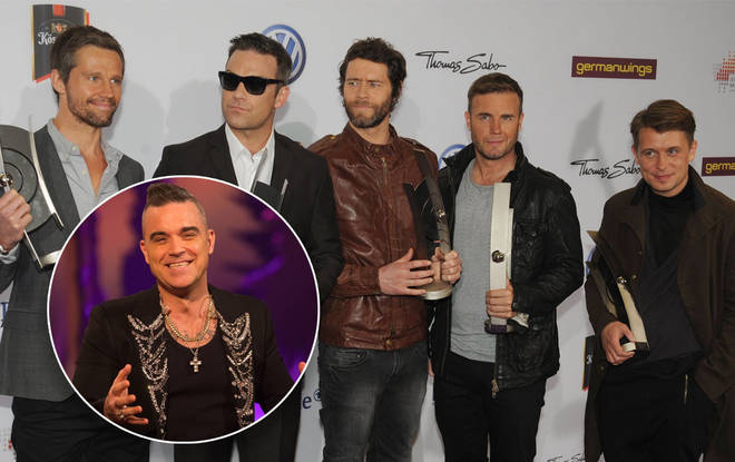 Take That will re-form in five years, says Robbie