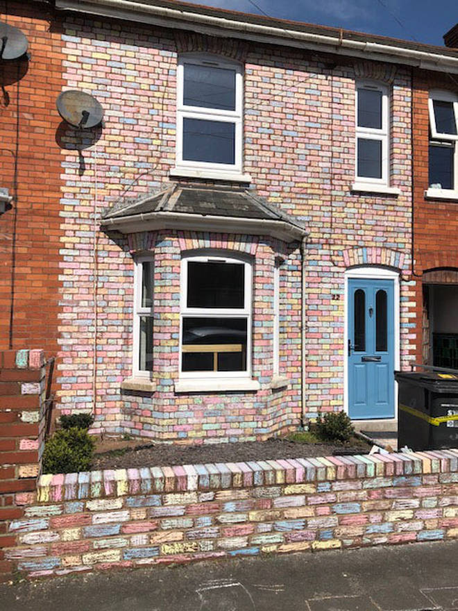 The Taylors spent six hours colouring in the bricks of their house