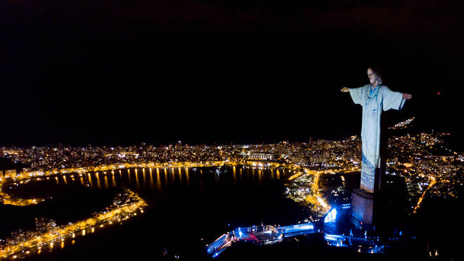 Christ the Redeemer was lit up to wear a doctors uniform as the words 'thank-you' and 'hope' were spelled over the clothing