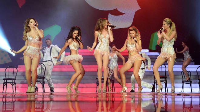 Kimberley Walsh, Nicola Roberts, Nadine Coyle, Cheryl Cole and Sarah Harding of Girls Aloud perform on their 'Ten - The Hits Tour' at The O2 Arena in March 2013.