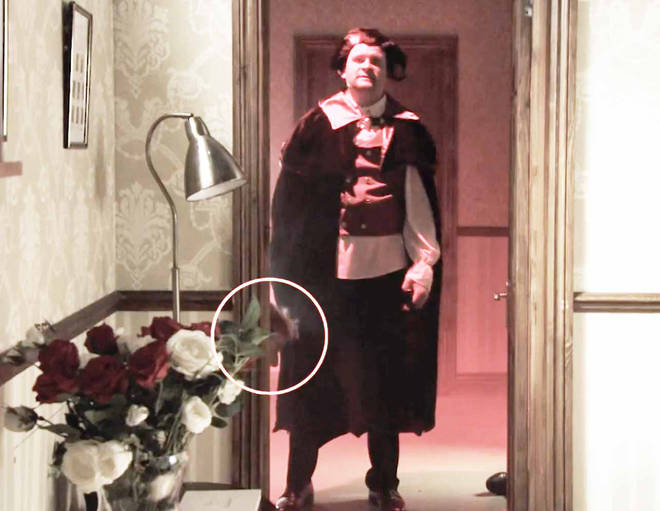 The scene shows a head pop out by the door frame