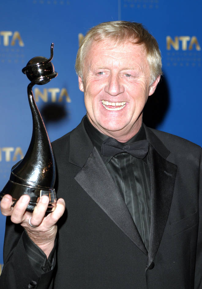 The real Chris Tarrant pictured winning the 2005 National Television Award for Best Quiz Programme