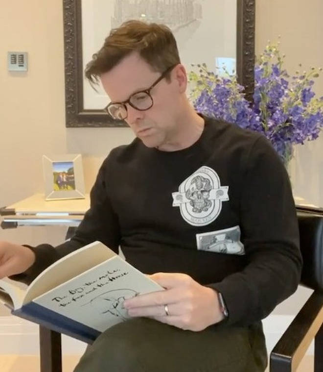 The video started with Dec reading a book