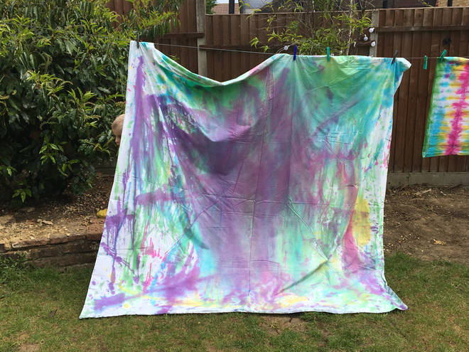 We 'experimented' by squirting dye at random over a double duvet cover - when it was washed and dried, it had a beautiful, ombre finish (pictured here pre-wash)