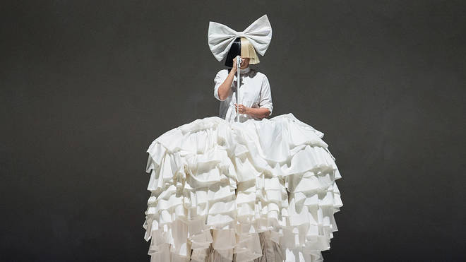 Sia is known for performing in a monochrome wig
