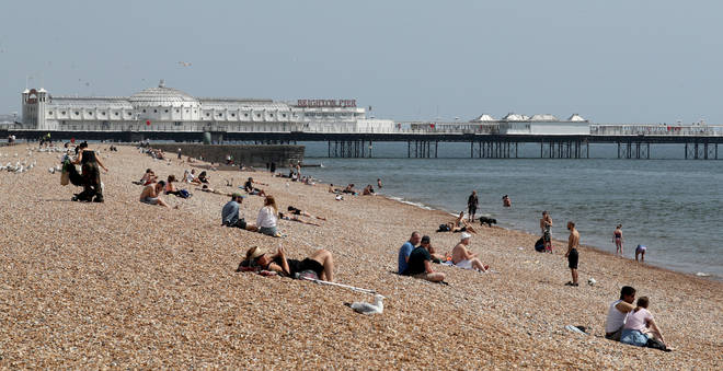 People in England are now able to sit in the sun under new lockdown guidance
