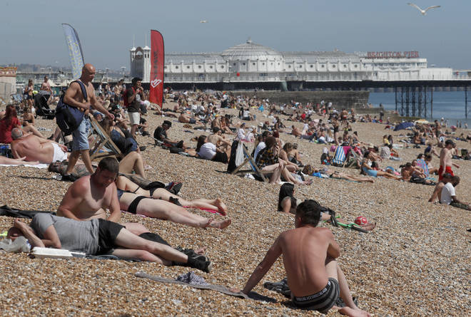 They were discussing pictures of packed beaches in England, such as this one of Brighton beach