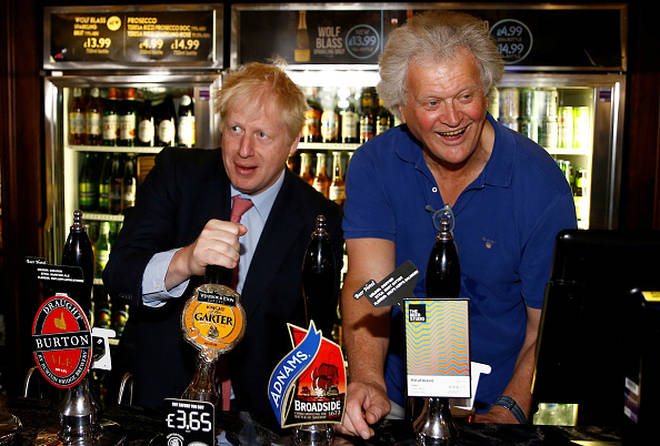 Boris Johnson with Tim Martin at Wetherspoons last July