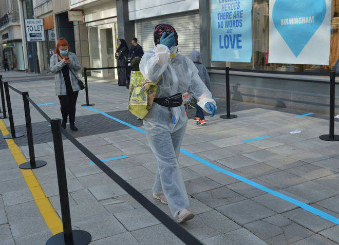 A woman in Birmingham is taking precautions in Primark