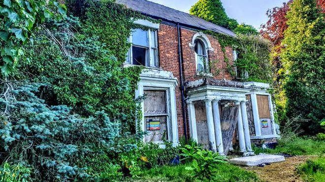 The front of the abandoned house
