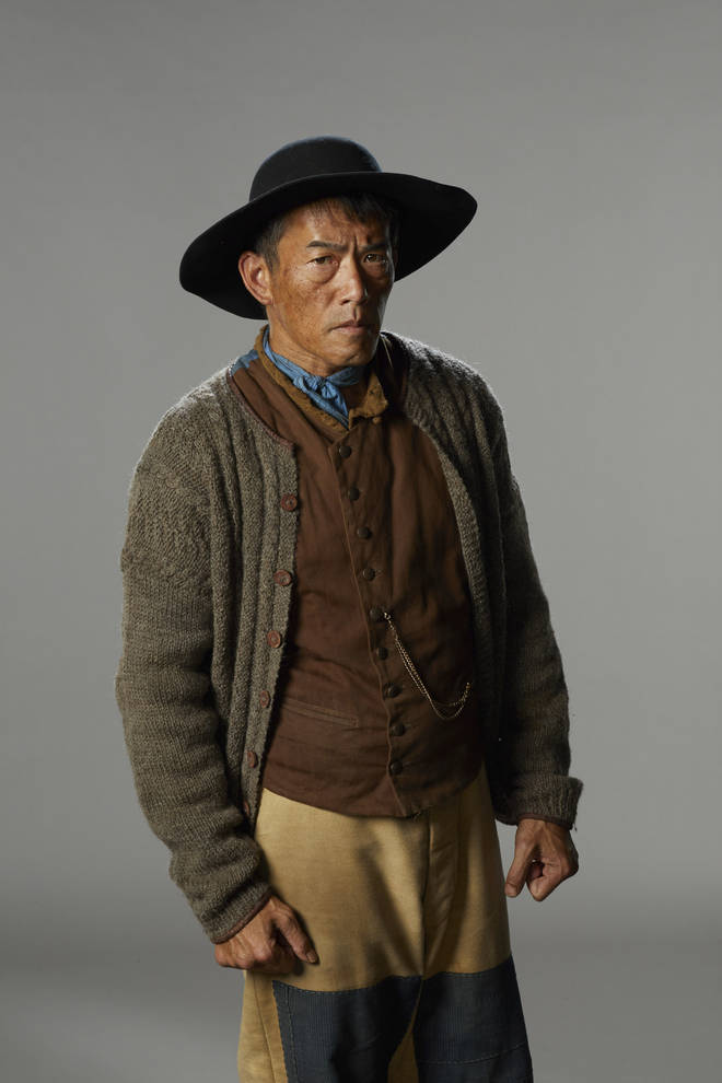 Gary Young as Quee Long in The Luminaries