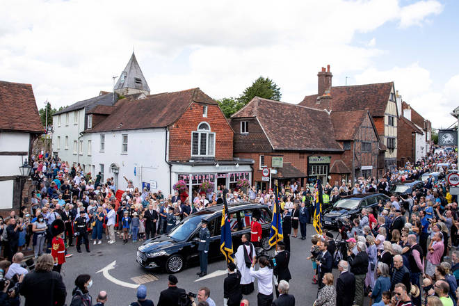 Hundreds of people paid their respects to Dame Vera as her coffin was carried through the village