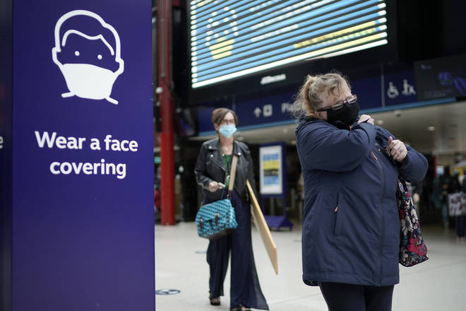 Face coverings are mandatory on public transport in England (stock image)