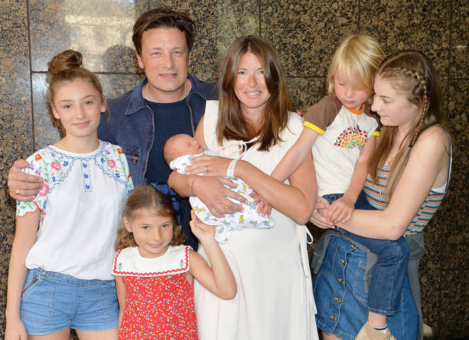 Jools and Jamie Oliver with their family