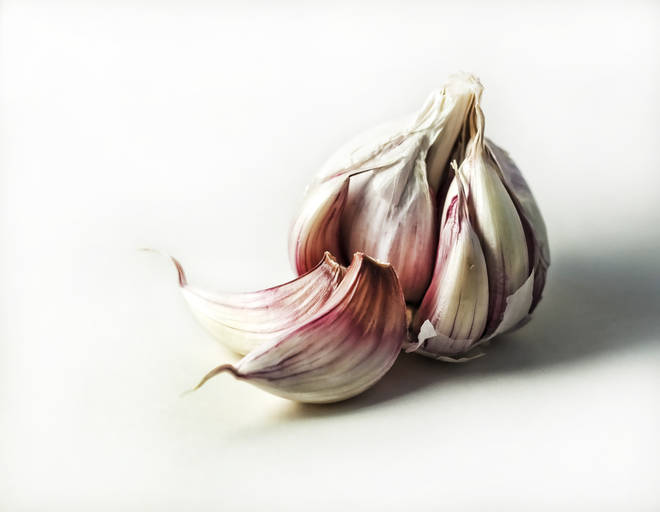 The 'correct' way to peel garlic has been revealed... (stock image)