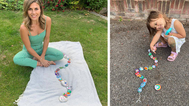 Zoe Hardman and her daughter Luna show off their stone snake