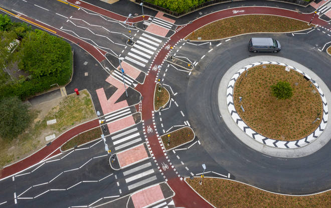 The roundabout has zebra crossings at every arm of the roundabout