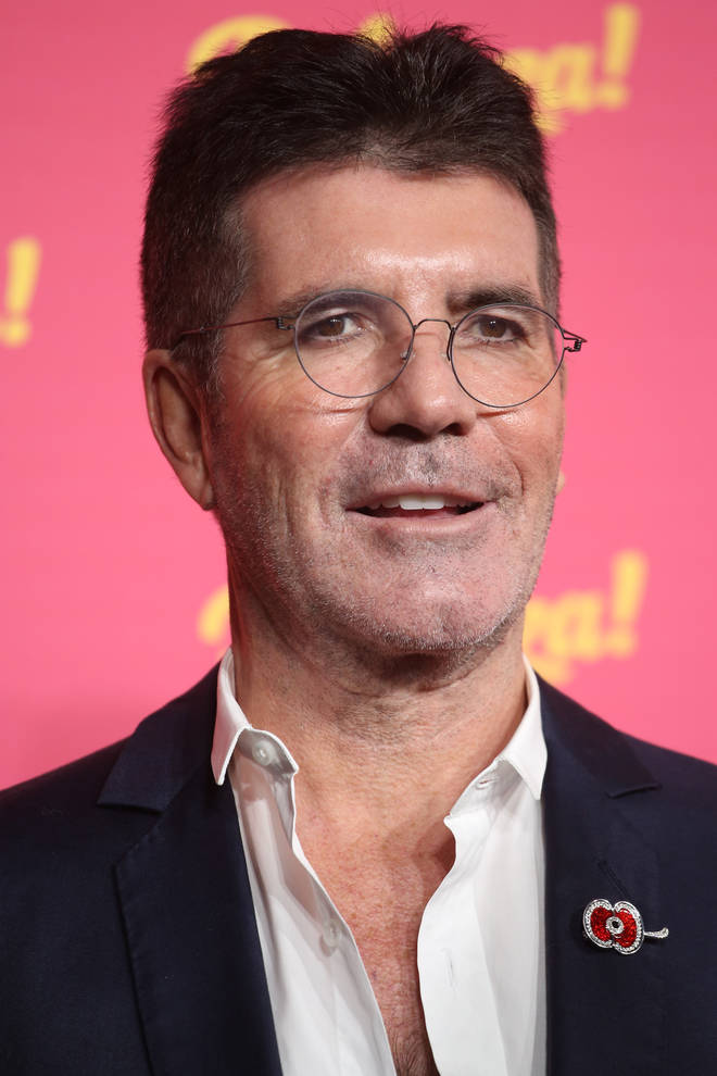 Simon Cowell was riding an electric bike when he fell and broke his back